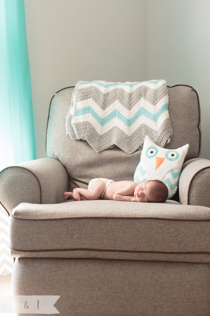 feather + light photography | main line, pa newborn lifestyle photographer | sleeping baby on chair | owl nursery