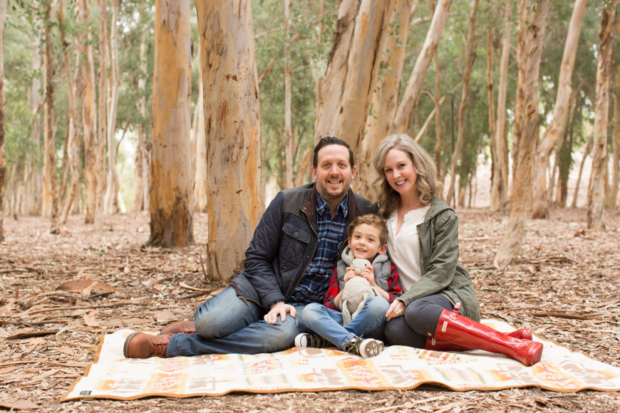 I absolutely love watching families and their littles grow! This is my third year taking the Smith Family photos and I have so enjoyed meeting up with them each and every single time. I also love the change of scenery. The first year we hit up Salt Creek, last year we strolled through downtown San Juan Capistrano, and this year we collected sticks in Serrano Creek Park. Here a just a few of my most favorites of this adorable family!